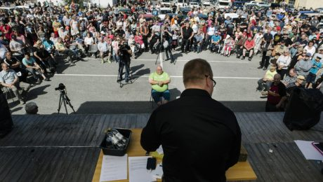 People gather for the auction of Asylum seekers' abandoned cars in Salla, northern Finland, on Friday July 15, 2016. Over 100 old cars, mostly Russian-made, driven across the northeastern Finnish border by asylum seekers and abandoned at the Salla border crossing point this past winter are auctioned in a two-day event in Salla. (Jouni Porsanger/Lehtikuva via AP) FINLAND OUT - NO SALES