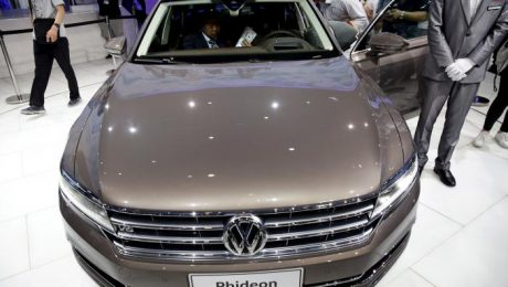 People gather around the Volkswagen's Phideon as it is presented during the Auto China 2016 auto show in Beijing April 25, 2016. REUTERS/Damir Sagolj/File Photo