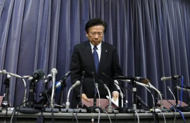 Tetsuro Aikawa, president and chief operating officer of Mitsubishi Motors Corp., arrives for a news conference at the Ministry of Land, Infrastructure, Transport and Tourism in Tokyo, Japan, on Tuesday, April 26, 2016. Mitsubishi Motors said it's improperly tested the fuel economy of its cars for the past quarter century, deepening a crisis that's already wiped out half its market value. Photographer: Tomohiro Ohsumi/Bloomberg *** Local Caption *** Tetsuro Aikawa