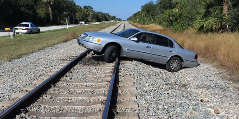 Woman leaves car on train tracks, charged with DUI