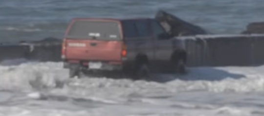 Nissan driver fights waves and surrenders