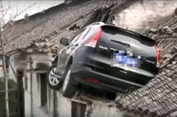 car stucks on roof, china
