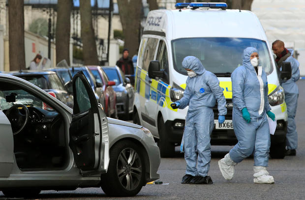 British police investigators after a car rammed Ukrainian ambassador car in London