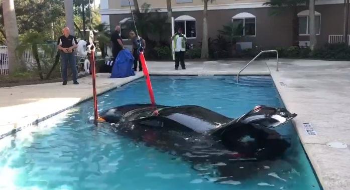 car crashes into the florida motel pool