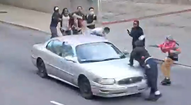 LMPD footage showing car hitting a protester