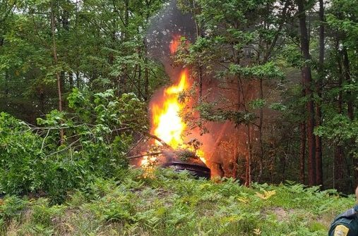 New Hampshire trooper rescues a man from burning car