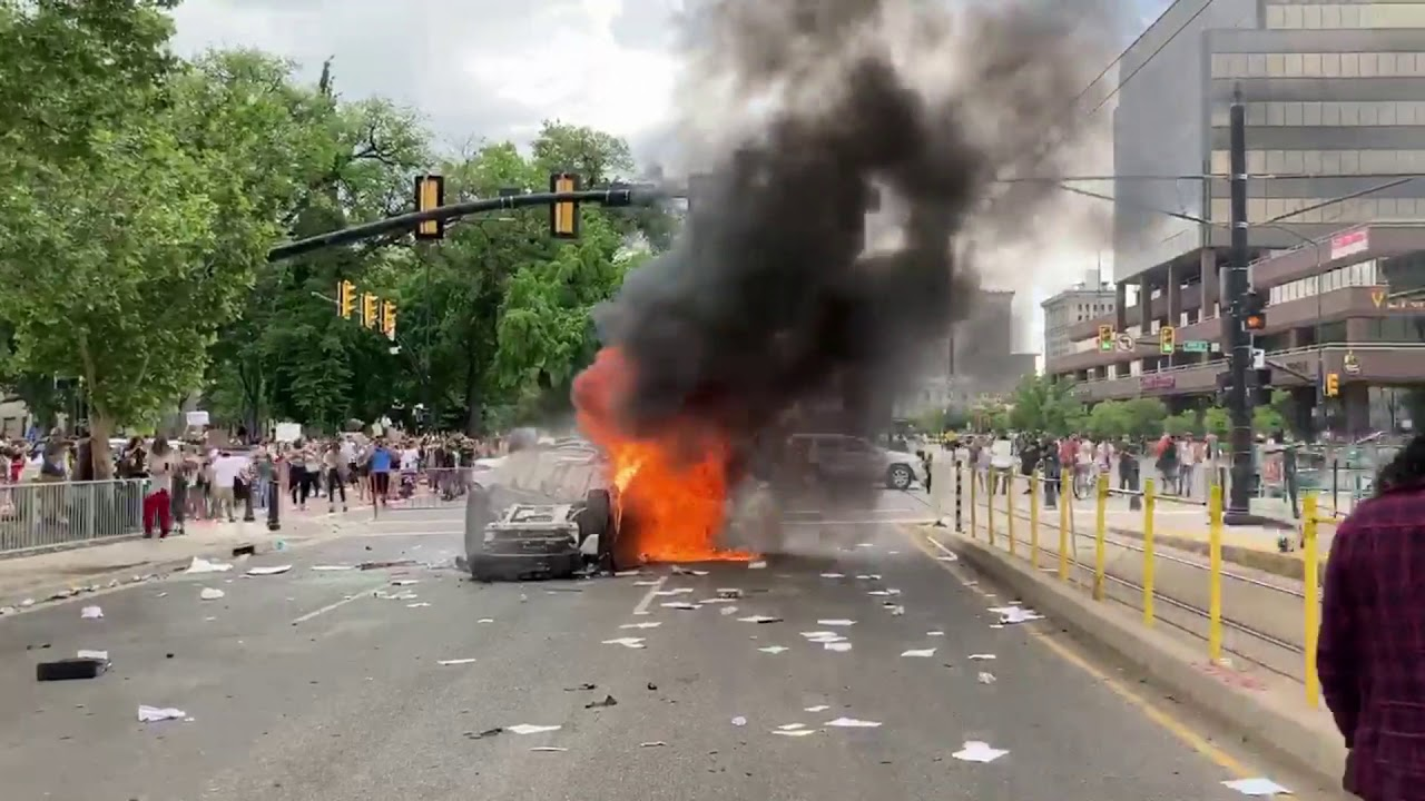 police car burning in salt lake city, during utah riots