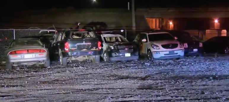 cars damaged in car dealership in Chicago