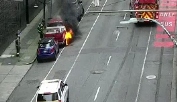 car setting on fire outside Seattle FBI field office