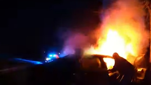 Georgia cops pulling passenger from a burning car