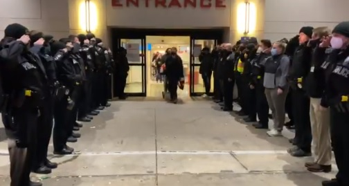 personnel saluting Dallas police officer Penton on his death